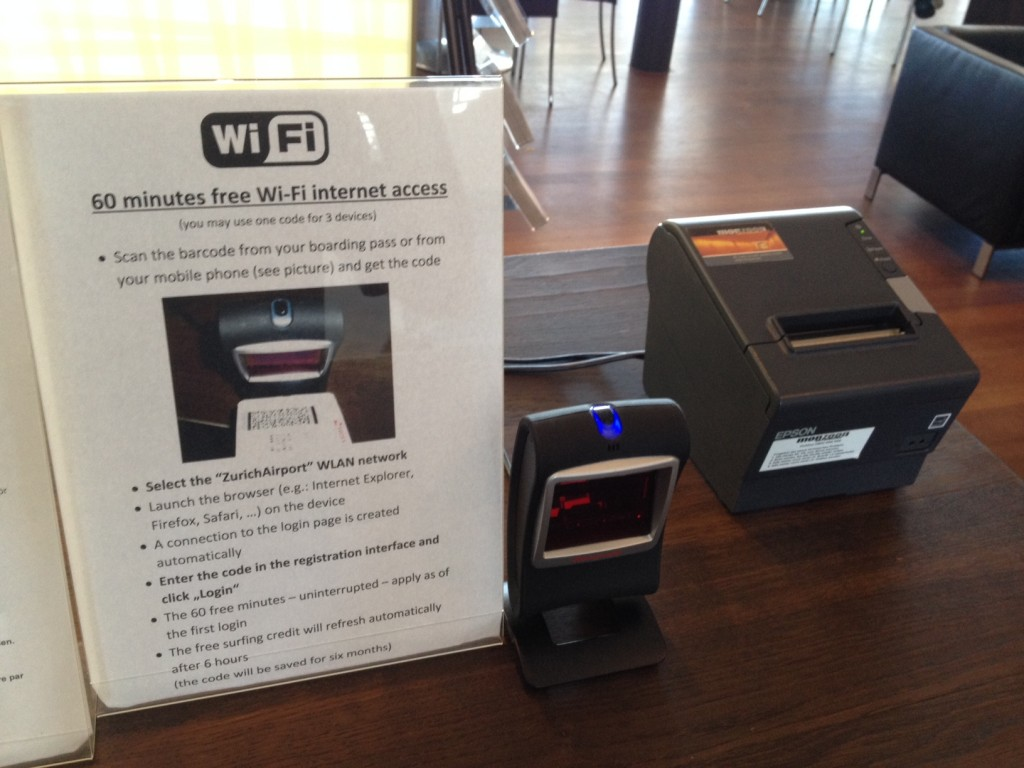 Boarding pass scanner and instructions at VIP lounge in Zurich Airport, Switzerland – required for internet access