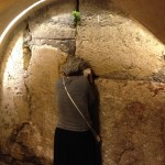 Woman weeps at Western Wall tunnel (2014)